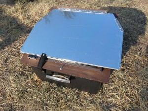 Solar oven folded down for storage.  Very portable.